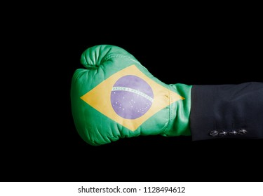 Male hand in Boxing glove with Brazil flag on black