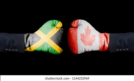 Male hand in Boxing gloves with Jamaica and Canada flags. Jamaica versus Canada concept. on black background