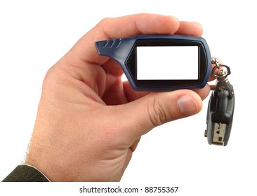 Male hand with car keys and radio trinket isolated with clipping path on white background. There are 2 clpping paths included.