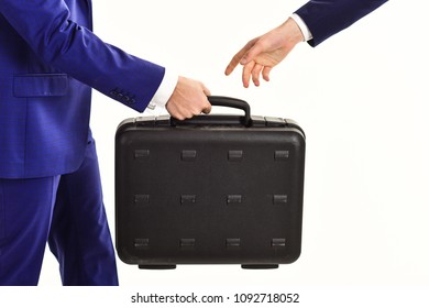 Male hand carry briefcase for exchange. Handover of case