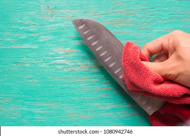 Male hand cleaning knife,Male hand cleaning knife with cloth before cooking,Chef cleaning knife.