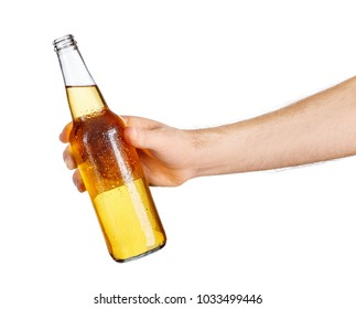 male hand with cold beer bottle isolated on white background