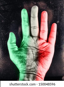 Male hand with colors of italian flag