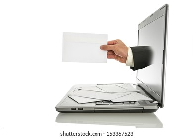 Male hand coming out of laptop monitor offering you an envelope. Isolated over white background.