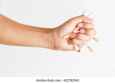Male hand crushing cigarette, Concept Quitting smoking,World No Tobacco Day