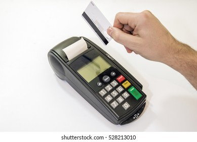 Male hand dials pin code on pin pad of card machine or pos terminal with inserted blank white credit card isolated on white background. Payment with credit card - businessman holding pos terminal.