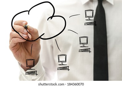 Male hand drawing cloud computing pictogram on a virtual interface with four computers connected to a cloud.