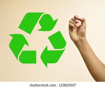 Male hand drawing recycle symbol