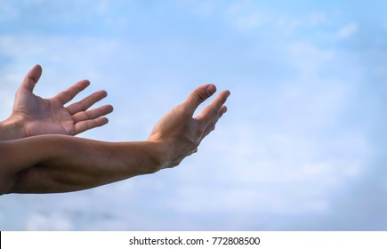 Male hand gesture and sign with blue sky background