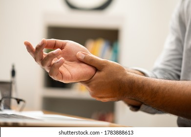 Male hand get hurt and pain in hand. Symptom office syndrome. He has symptom stress in his hand stiffness causing inconvenience.