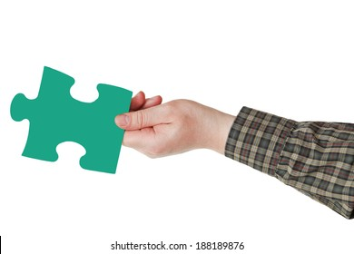 male hand with green puzzle piece isolated on white background