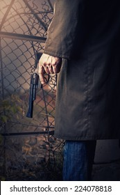 Male Hand with gun (revolver) outdoor.