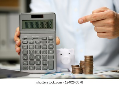 Male hand hold calculator in hand home office setting. Calculation of family expenses social income population freelance irs situation growth research concept