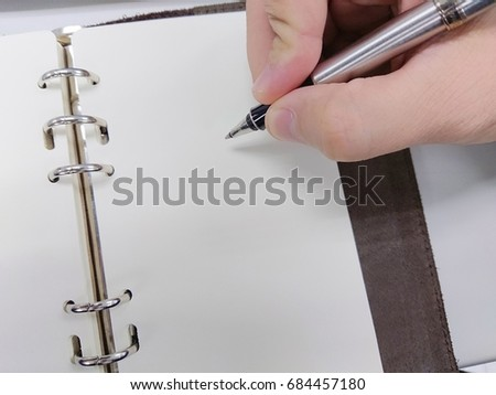 Male Hand Hold Pen Write Sign Stock Photo Edit Now 684457180