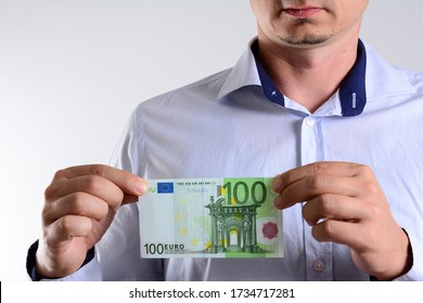male hand holding 100 Euro banknote. Money (Euro) in a hand isolated on white. Savings, finances, economy and home concept .Man counting euro.Crisis after the covid-19 epidemic.