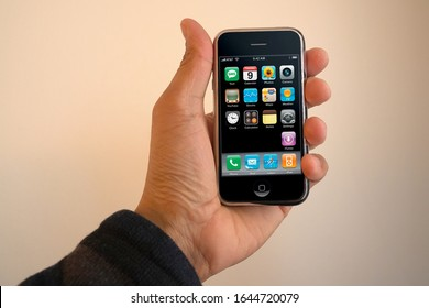 A male hand holding a 1st generation iPhone with the main display turned on in landscape layout. Originally released June 2007. February 13, 2020. San Francisco, CA.
