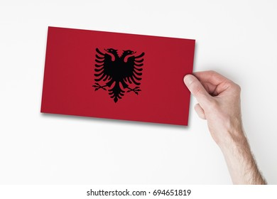 Male hand holding albania flag