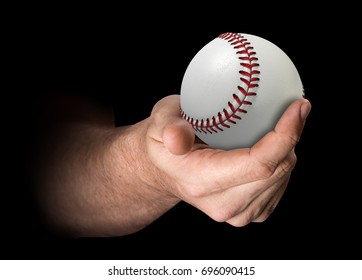 A male hand holding a baseball on an isolated dark background - 3D render