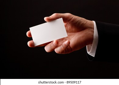 Male hand holding blank business card. Add your own design