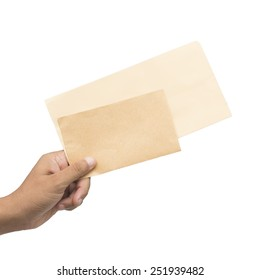 Male hand holding blank envelopes isolated on white background