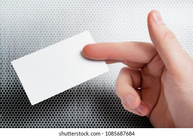 Male hand holding business card with blank copy space
