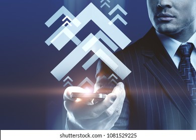 Male hand holding cellphone with digital media arrows. Technology and communication concept. Double exposure