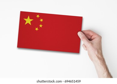 Male hand holding china flag