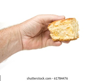 Male hand holding chunk of Brioche laced with creme custard isolated on white.