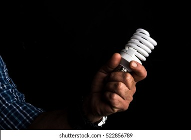 Male hand holding a compact fluorescent light (CFL)