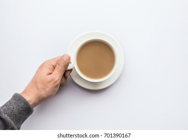 Male hand holding cup of coffee.business and drink concepts