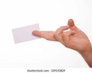 Male hand holding an empty business card, white background