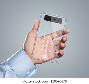 Male hand holding futuristic transparent mobile smart phone with copy space