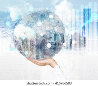 Male hand holding globe with networking system around on Singapore city background. Double exposure. Elements of this image furnished by NASA