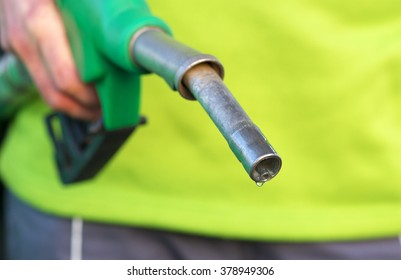 Male hand holding green pump
