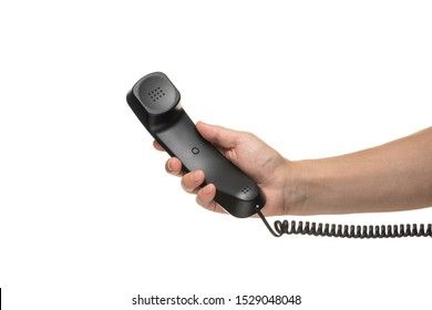 Male hand holding a handset on white background