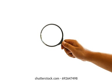 Male hand holding a magnify glass isolated on white background, clipping path.