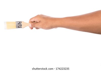 Male hand holding a paint brush over white background