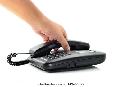 Male hand holding phone receiver over telephone