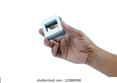 male hand holding a pile of frames film slide isolated on white background