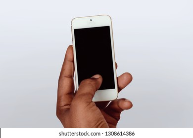 Male hand holding smartphone with blank screen. Isolated on white background.