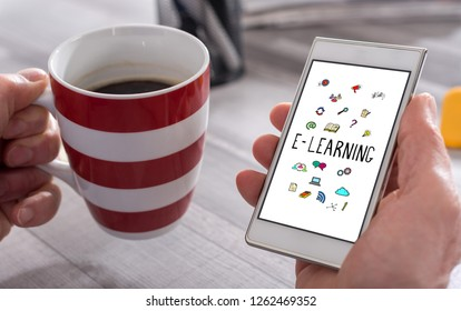 Male hand holding a smartphone with e-learning concept