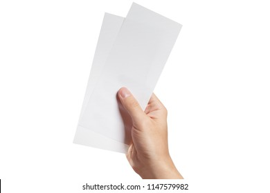 Male hand holding two blank sheets of paper (tickets, flyers, invitations, coupons, banknotes, etc.), isolated on white background