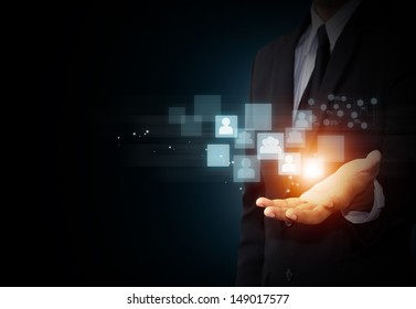 Male hand holding virtual icon of social media