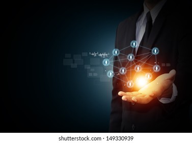 Male hand holding virtual icon of social network