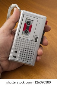 Male Hand Holds Audio Cassette Recorder using Tape for documenting sound