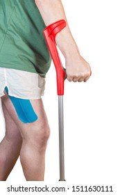 Male hand holds the modern metal elbow crutch, fragment of man body and crutch on a white background