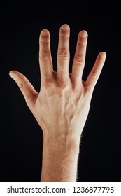 male hand, isolated on black