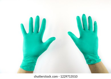 Male hand in medical glove on white background.