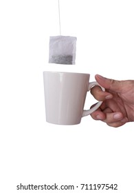 Male hand with mug tea bag on top isolated on white background,Clipping path separate hand and tea bag.