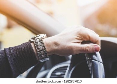 Male hand on steering wheel. Travel and safty concept. - Stock image